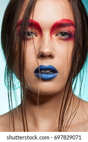 Close up portrait of Gorgeous beautiful young model with creative make up and hairstyle. Beauty and fashion. Artistic on stage make up