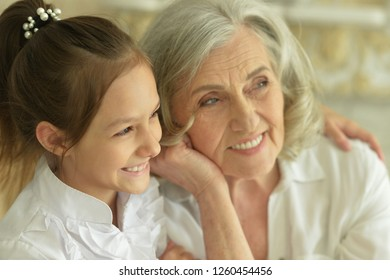 Close up portrait of grandmother and granddaughter posing