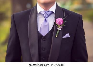 close up portrait of groom suit