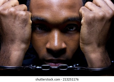 close up portrait of hand cuffed black man