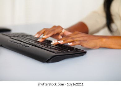 Close up portrait of the hands of a pretty woman working on computer
