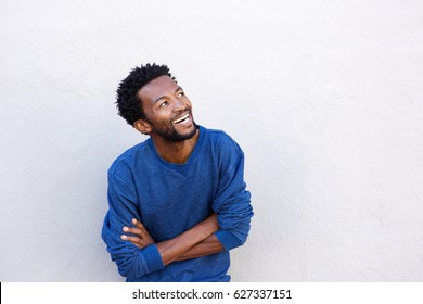 Close up portrait of handsome african american man with arms crossed smiling