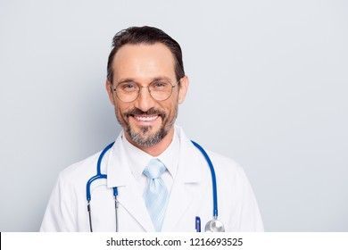Close up portrait of handsome attractive good-looking diagnostic assistant man with stethoscope on his neck look at camera make toothy hollywood smile isolated on light gray background