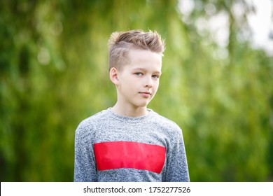 close up portrait of handsome boy teenager in green background