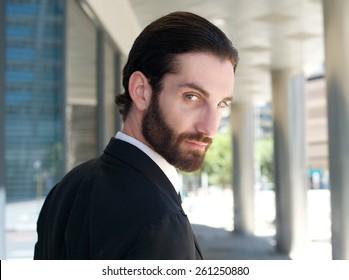 Close up portrait of a handsome businessman looking over shoulder