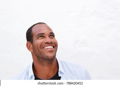 Close up portrait of handsome confident man laughing on white background