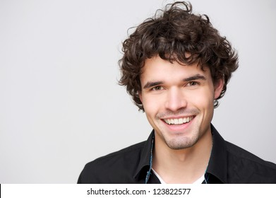 Close up portrait of a handsome guy with a smile on his face