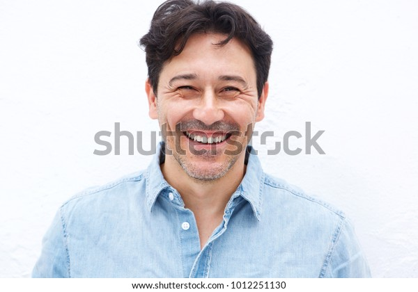 Close up portrait of handsome mature guy smiling against white background