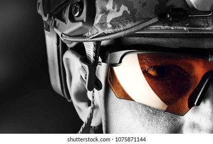close up portrait of handsome military man. Macro shot on black background