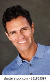 Close up portrait of handsome older man smiling with blue shirt