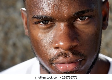 Close up portrait of a handsome sports man sweating after work out exercise