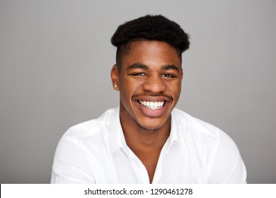 Close up portrait of handsome young african american man against gray background