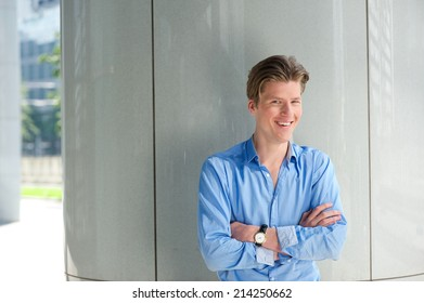 Close up portrait of a handsome young businessman smiling