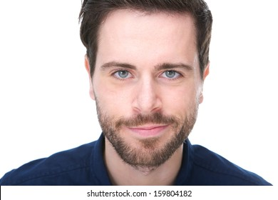Close up portrait of a handsome young man with beard smiling