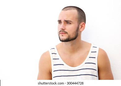 Close up portrait of a handsome young man with short hair and beard looking away