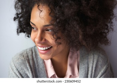 Close up portrait of a happy african american woman smiling