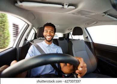 Close up portrait of happy african american man with beard driving car