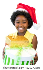 Close up portrait of happy African girl holding christmas presents. Laughing kid wearing red hat isolated on white background.
