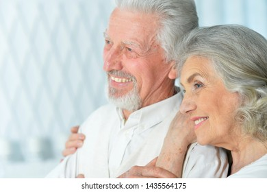 Close up portrait of happy beautiful senior couple posing at home