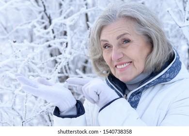 Close up portrait of happy beautiful senior woman posing
