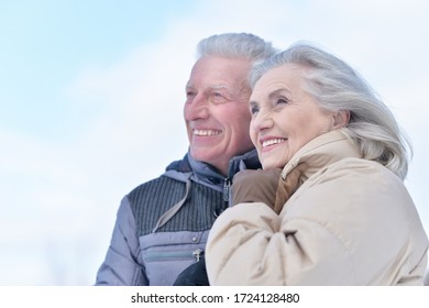 Close up portrait of happy beautiful senior couple posing at winter outdoors