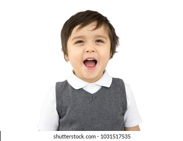 Close up Portrait of happy boy in school unoform with a big smaile isolated on white background, Schoolboy showing his teeth and looking up, Healthy child concept