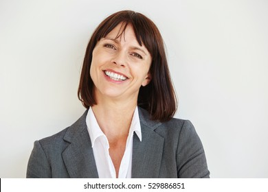 Close up portrait of happy business woman standing by white wall