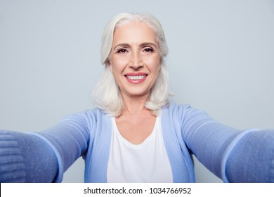 Close up portrait of happy cheerful excited delightful with toothy beaming smile granny grandmother grandma having a video call via internet, isolated on gray background