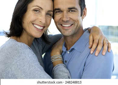 Close up portrait of a happy couple - woman and man in their forties