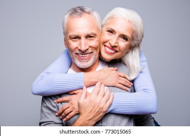 Close up portrait of happy excited senior couple, they are embracing and smiling, they love each other