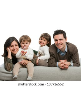 Close up portrait of happy family relaxing on couch.Isolated.