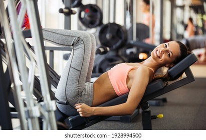 Close up portrait of happy fit woman exercising in gym