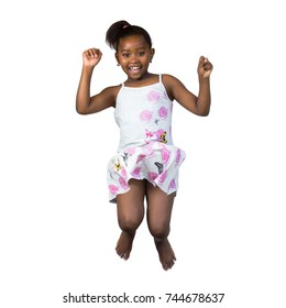 Close up portrait of happy little african girl jumping high with arms raised.Isolated on white background.