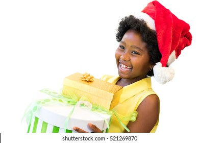 Close up portrait of happy little afro american girl wearing christmas hat, Kid holding christmas gifts isolated on white background.