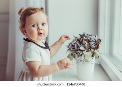Close up portrait of a happy little child in white dress. Childhood, happiness concept