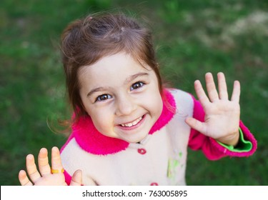 Close up portrait of happy little girl smiling to the camera
