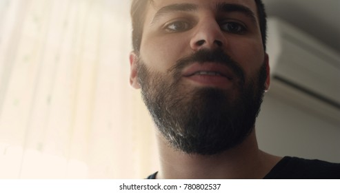 Close up portrait of a happy man in his 20s