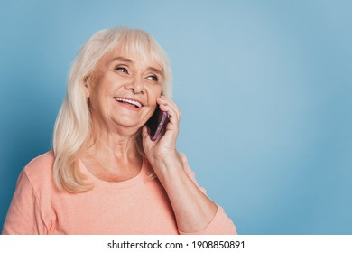Close up portrait of happy mature woman talking on smartphone