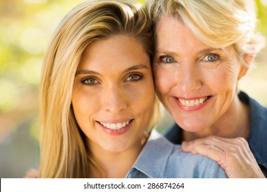 close up portrait of happy mother and daughter