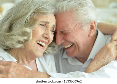Close up portrait of happy senior couple posing