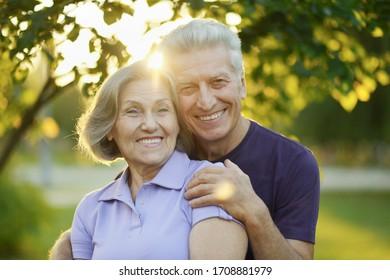 Close up portrait of happy senior couple posing in park