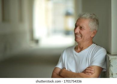 Close up portrait of happy senior man at home