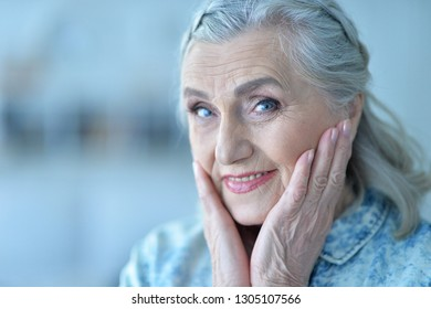 close up portrait of happy senior woman  at home
