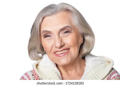 Close up portrait of happy senior woman posing against white background