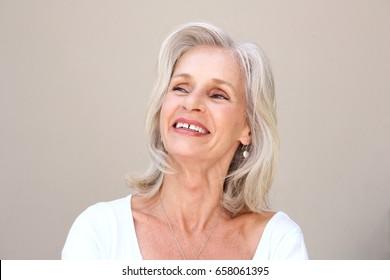 Close up portrait of happy senior woman smiling