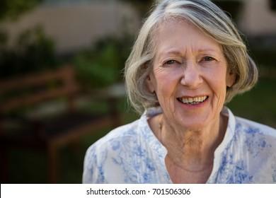 Close up portrait of happy senior woman at park