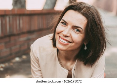 Close up portrait of a happy smiling woman