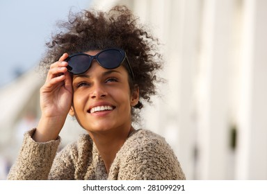 Close up portrait of a happy smiling young woman outside