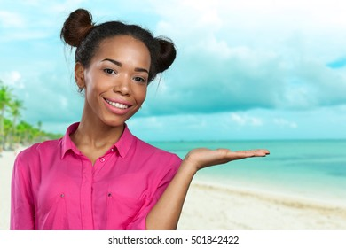 Close up portrait of a happy woman pointing