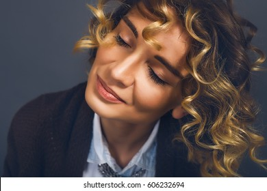 Close up portrait happy woman.Indoor portrait,boho style,curly hair,pretty face,face care,detailed portrait,red lips,blue skirt,emotions,country outfit,young hipster,close eyes,dreamer,traveler